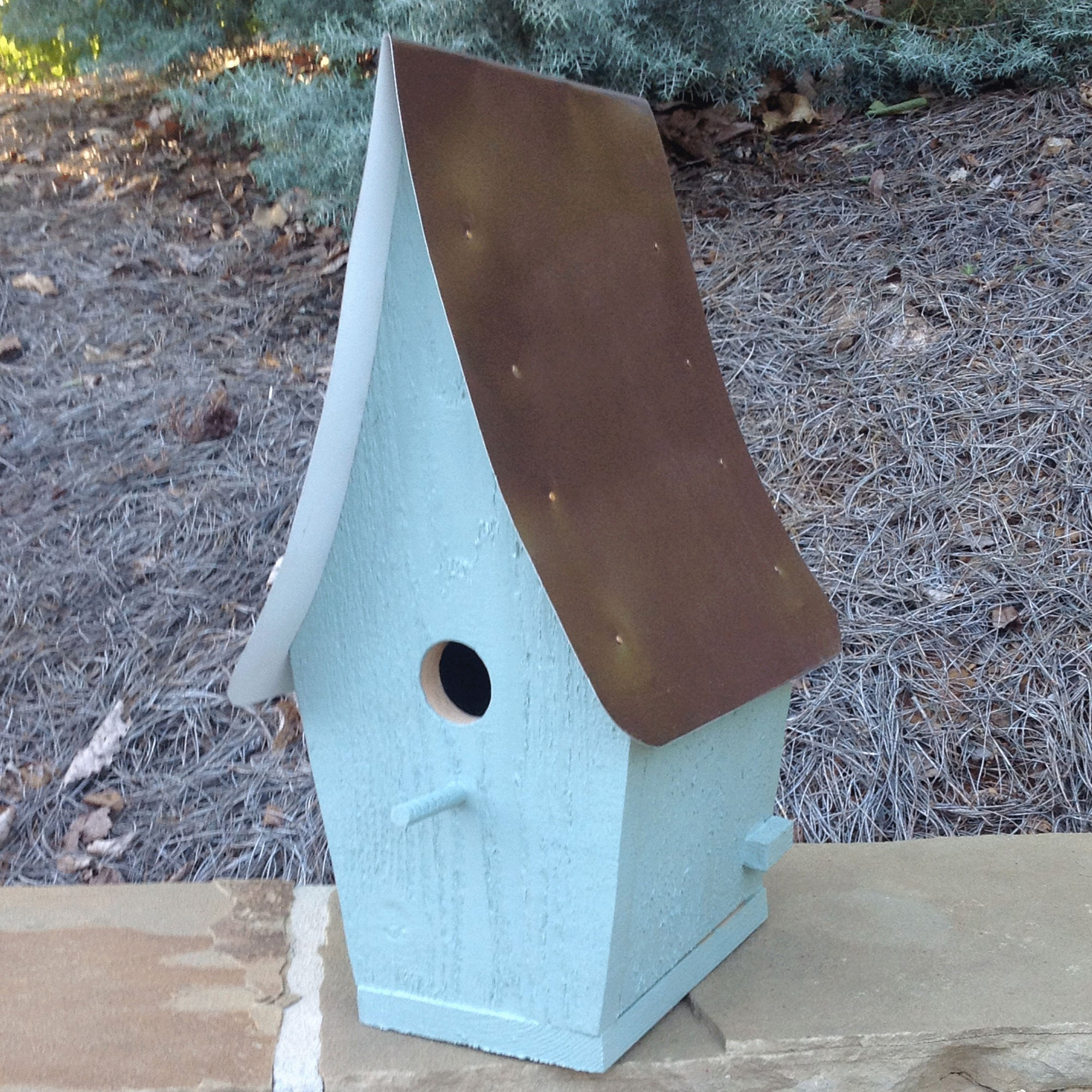 large bluebird house painted country blue with brown tin tall pointed roof