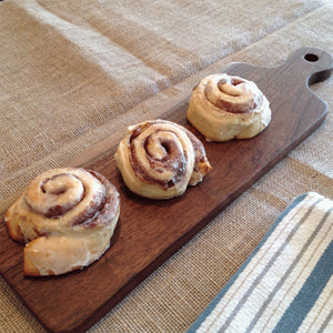 Walnut bread board with 3 large warm homemade cinnamon rolls  by Michael's Woodcrafts Greenville SC woodworkers woodworking