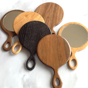 Walnut and cherry wood hand mirrors