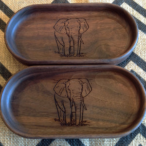Two handcrafted walnut catchall trays both have an elephant walking toward you engraving on the bottom  by Michael's Woodcrafts Greenville SC woodworker Woodworking artist woodworkers