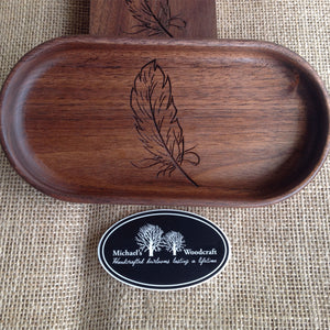 Handcrafted walnut catchall tray 4 x 8 inches with a beautiful feather engraved on the bottom  by Michael's Woodcrafts Greenville SC woodworker Woodworking artist woodworkers