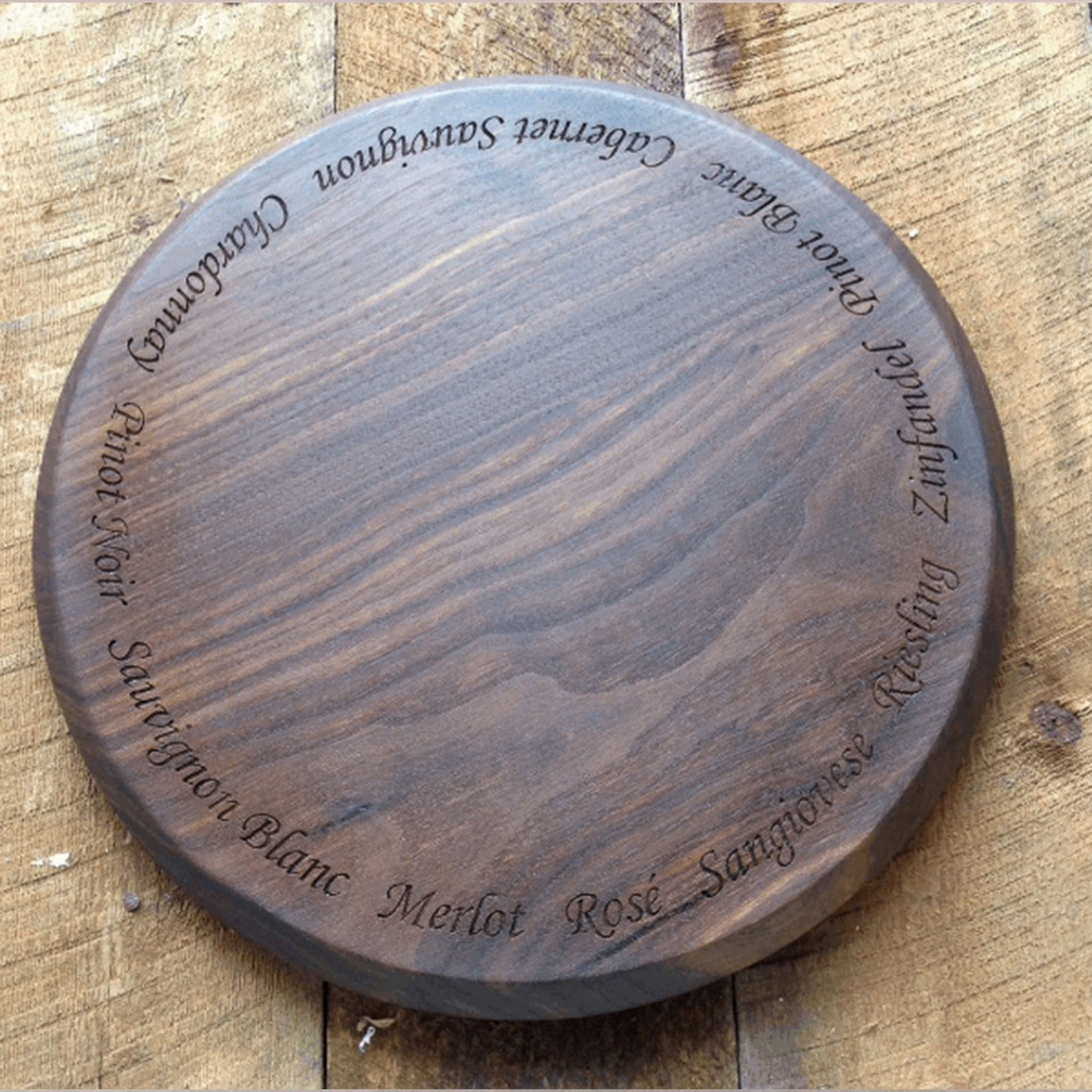 Beautiful round walnut tray with wine names engraved all around the edge  by Michael's Woodcrafts Greenville SC woodworkers woodworking