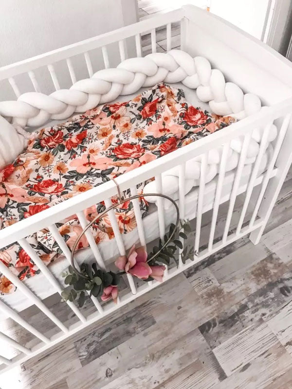 Floral Baby Swaddle Wrap in cot