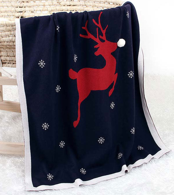 Red Reindeer Baby Blanket in Bassinet