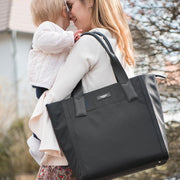 Storksak Eliza Black Nappy Bag with Mum & Baby