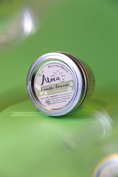 Atoca chamomile lotion bar in it's reusable packaging