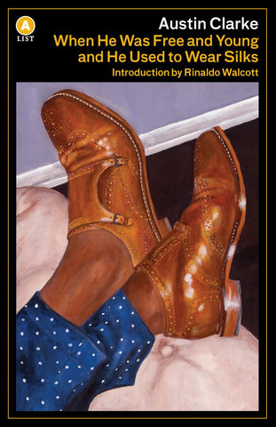 The cover of When He Was Free and Young... Features the criss-crossed ankles of a man with a dark skin tone wearing shiny brown shoes.