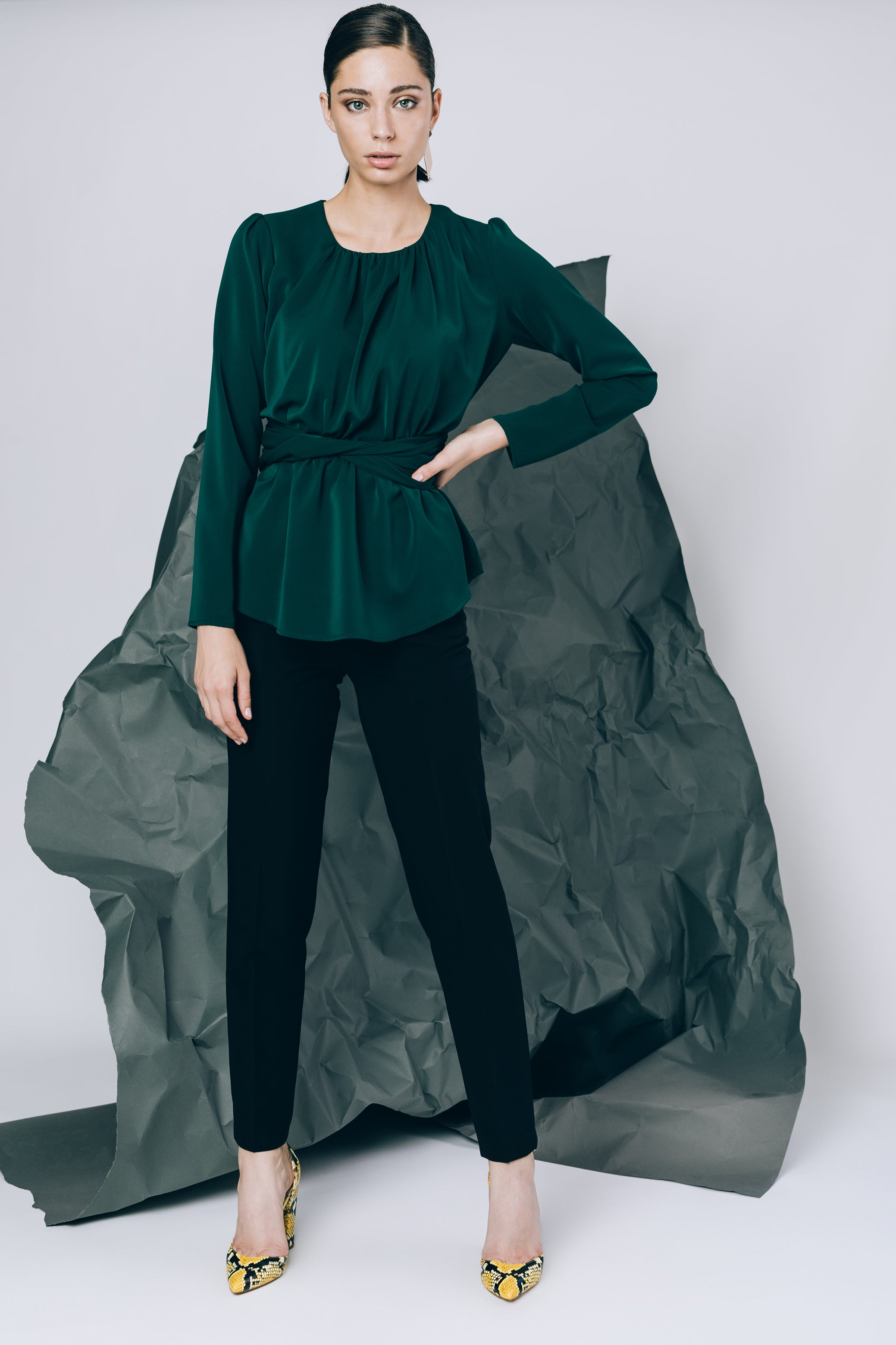 Emerald green blouse with twisted belt