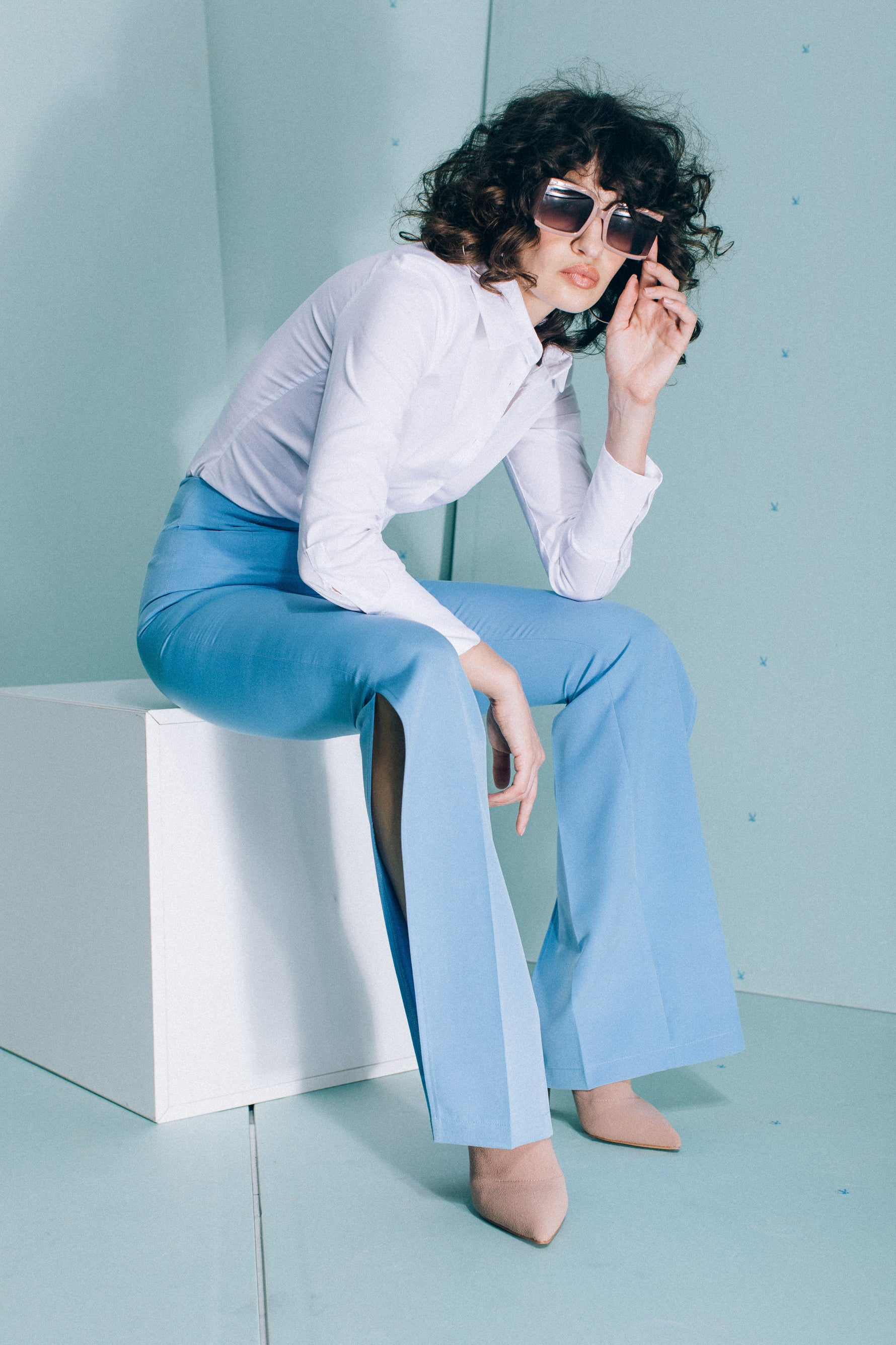 High-waist flared trousers with split hems