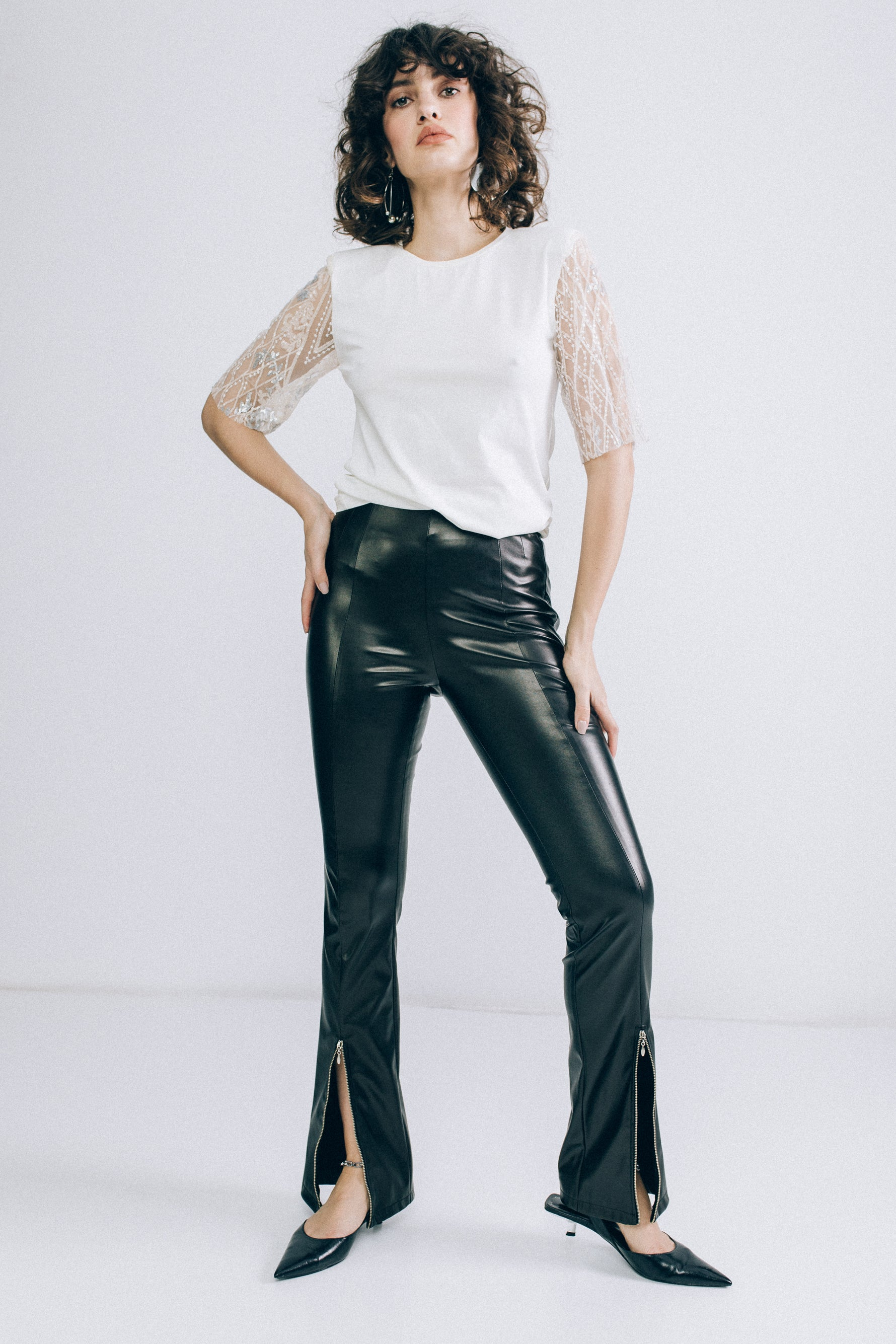 High-waist faux leather flared trousers