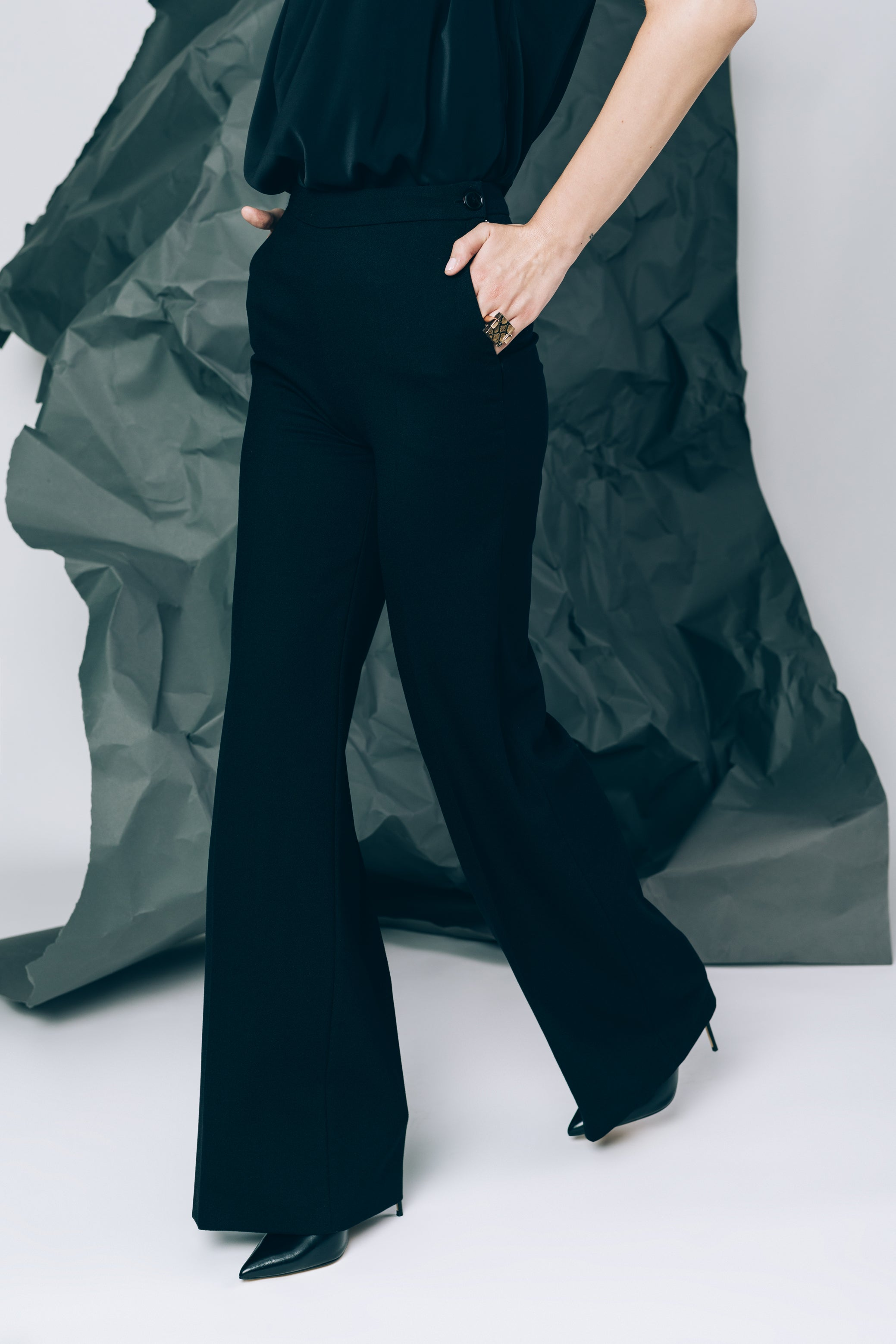 Black high-waist wide leg trousers with side pockets