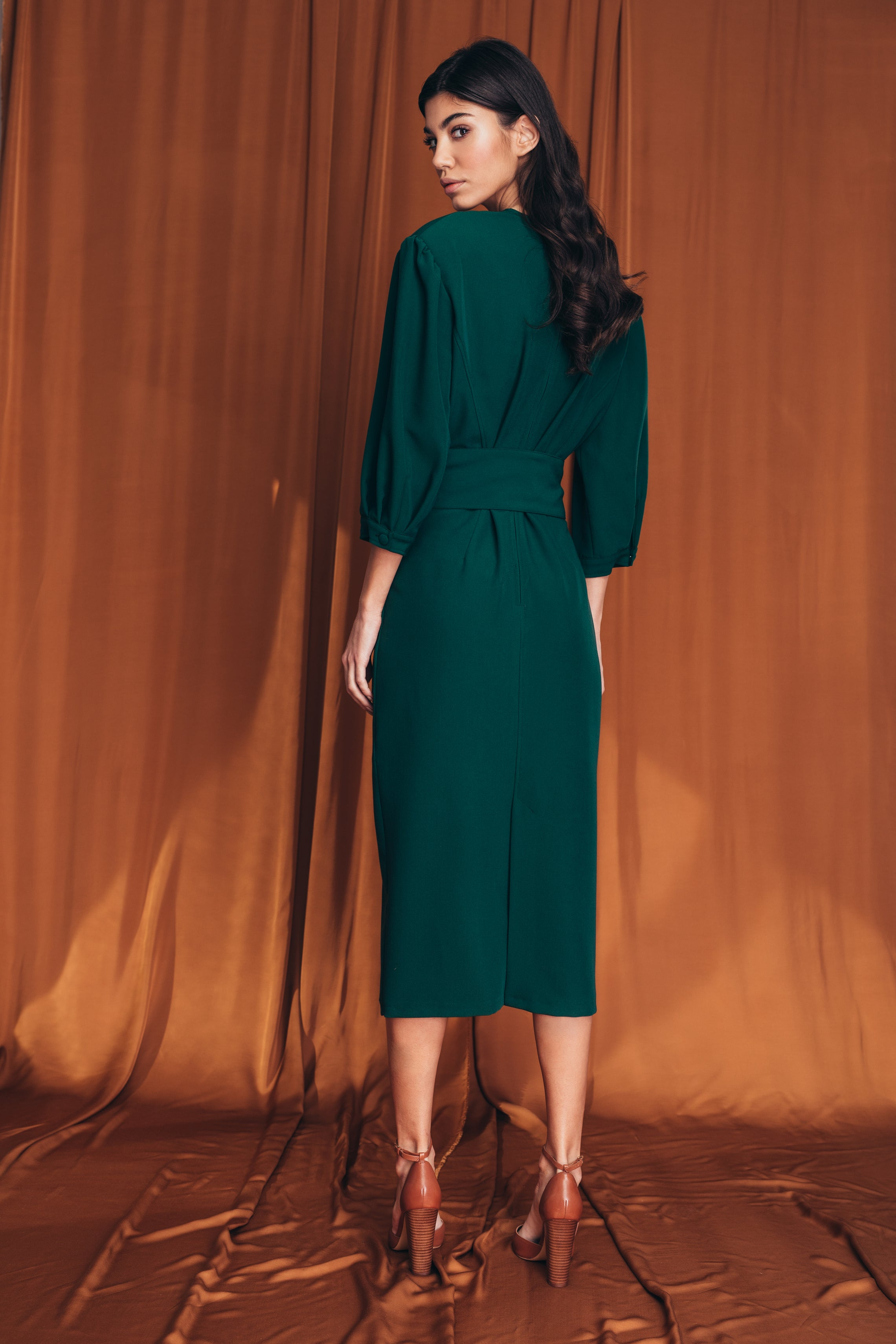Draped emerald green midi dress
