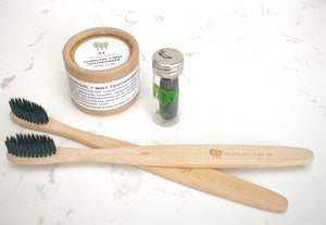 Two Bamboo Toothbrushes + Eco Dental Floss + Charcoal Toothpowder Kit