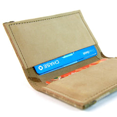 Leather bifold wallet with money clip, made in the USA out of combat boot leather.