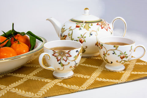 tea for two with fine china and healthy mandarins for a snack