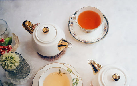 teapots, tea cups, and saucers