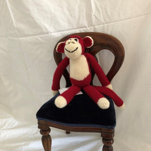 Red and White Monkey by Parkville Auxiliary