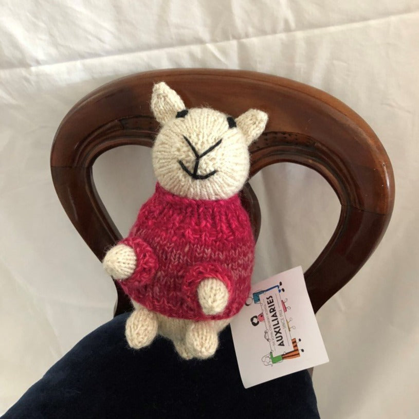 Sheep with red jumper by Parkville Auxiliary