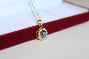14 Karat Yellow Gold and Diamond Pendant
