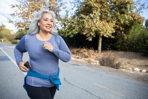 An elderly woman running outside who is participating in virtual runs in the US