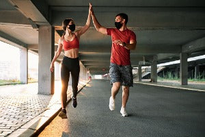 A couple doing virtual running in the US
