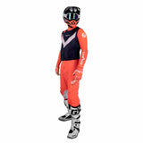 Pictured is the Seven Zero Victory Coral/Navy outfit - Zero Over-Jersey in Navy with the Zero Compression Jersey and Pants in Coral