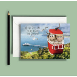 Image of greeting card with Great Orme goats in a cable car