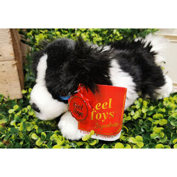 Image of black and white soft toy dog