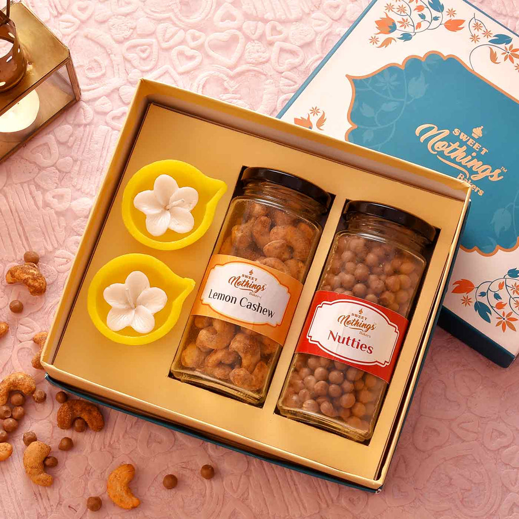 Amazing Hamper Of Nutties & Lemon Cashews With 2 Diya-Floral Candles