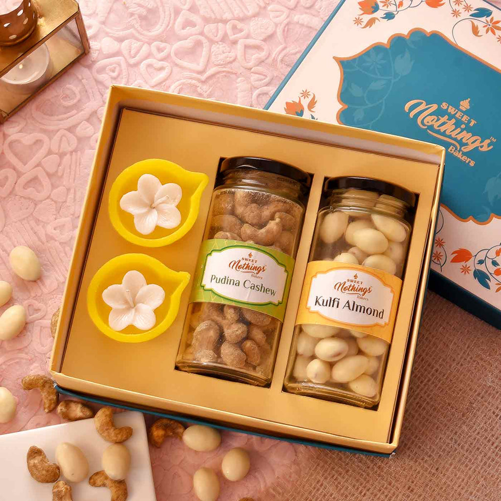 Impressive Hamper Of Pudina Cashew, Kulfi Almond & Diya Floral Candles