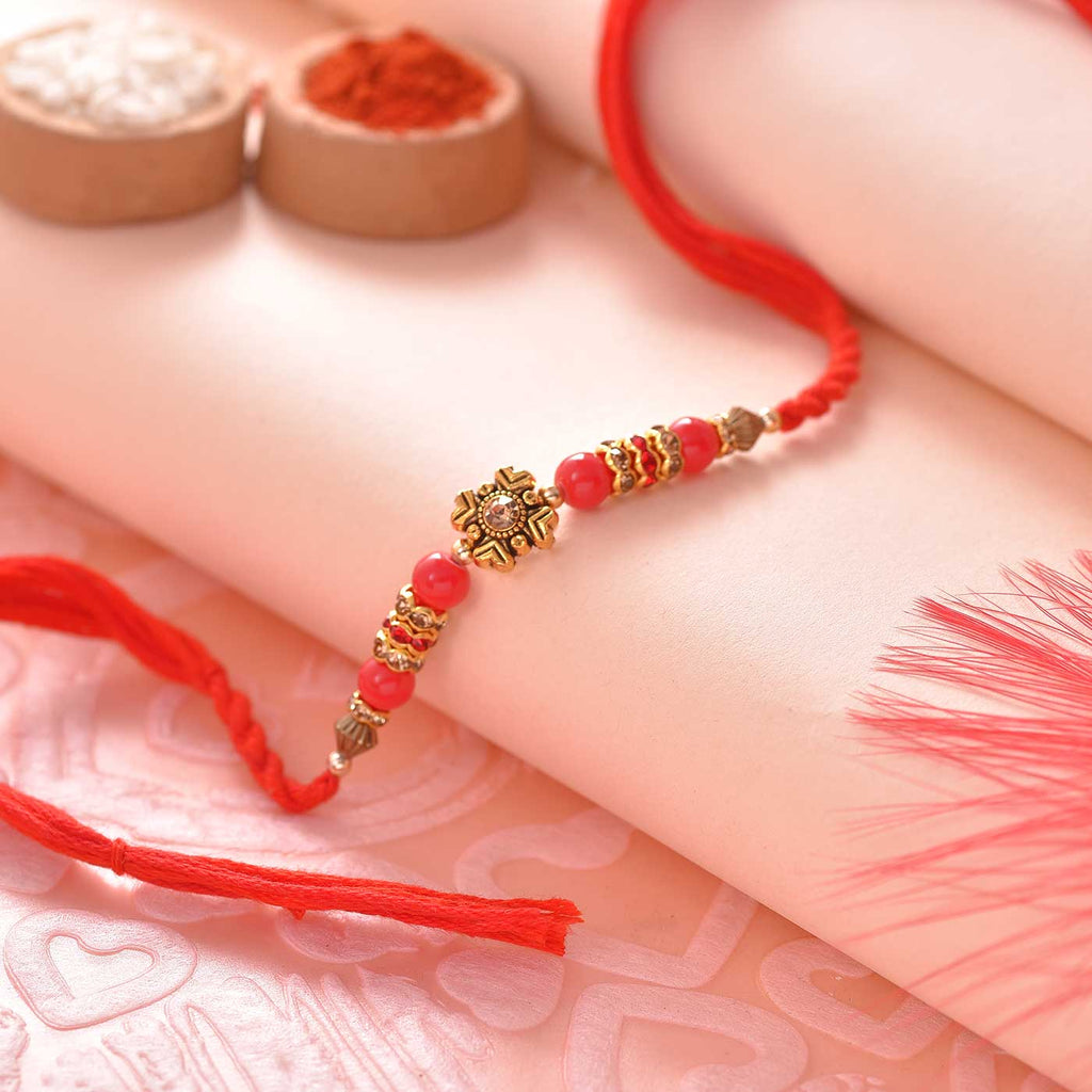 Floral Pattern & Red Beads Rakhi Thread