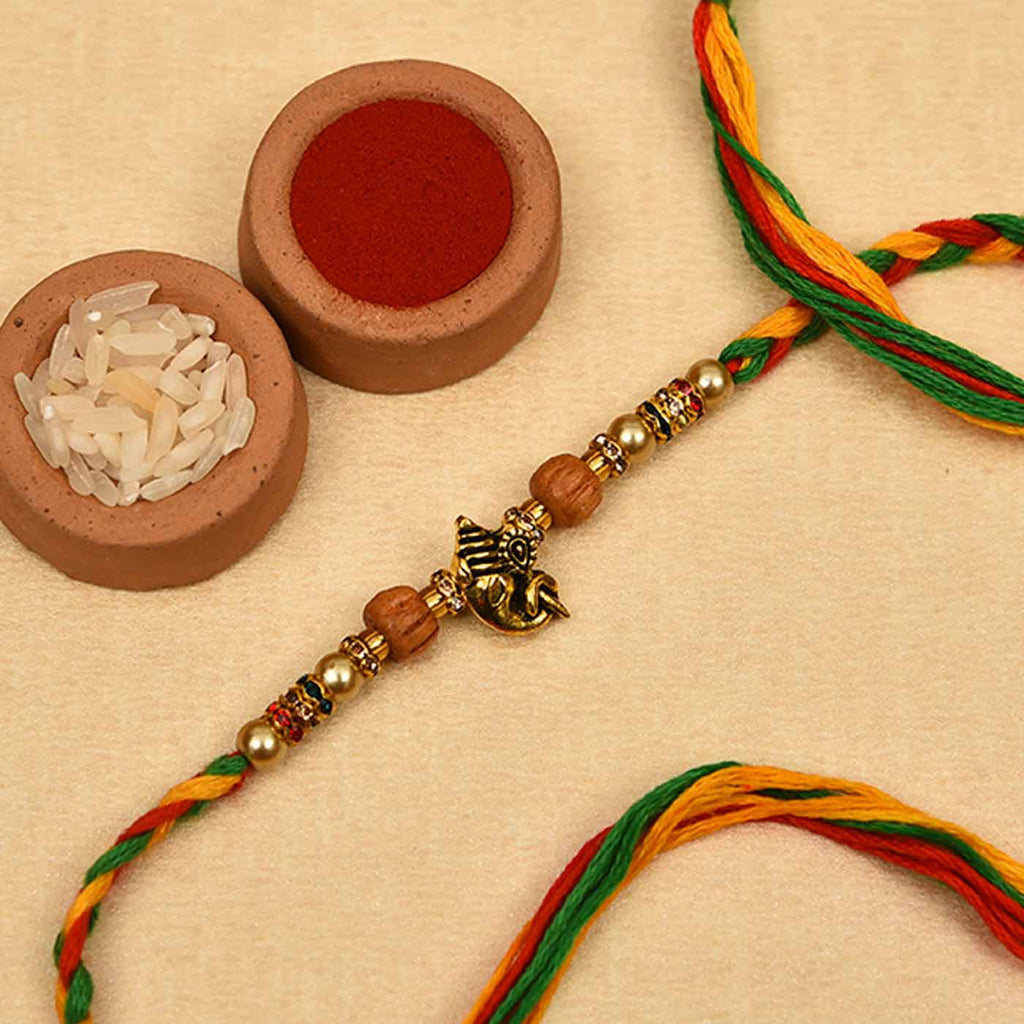 Awesome Ganesha Pearls & Wooden Beads Rakhi