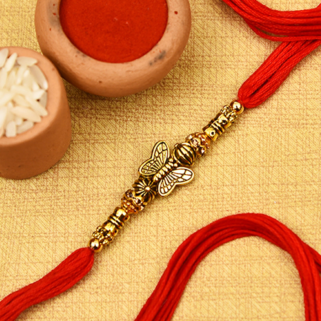 Pretty Antique Gold Finish Butterfly Rakhi