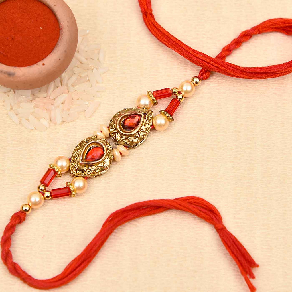 Metallic Look Red Stone & Pearls Rakhi