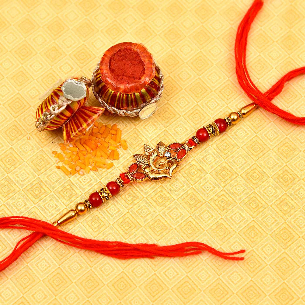 Fancy Metallic Ganesha And Red Beads Rakhi