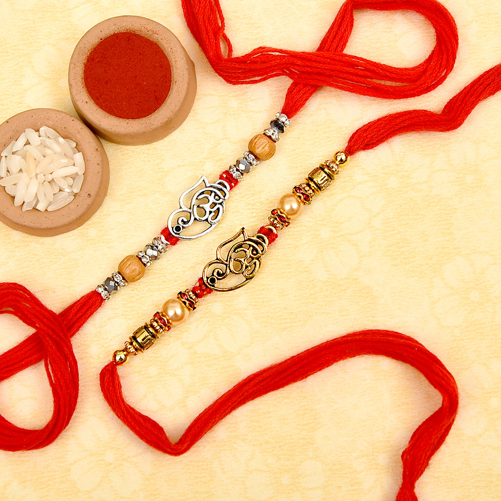 Om Ganesha Beads & Pearls Set Of 2 Rakhis With Soan Papdi