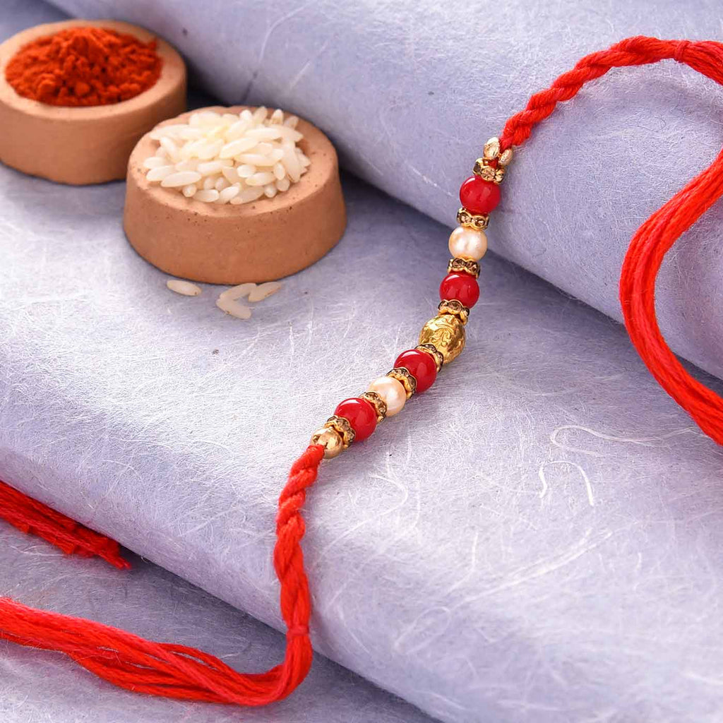 Spectacular Red Beads & Pearls Rakhi Thread