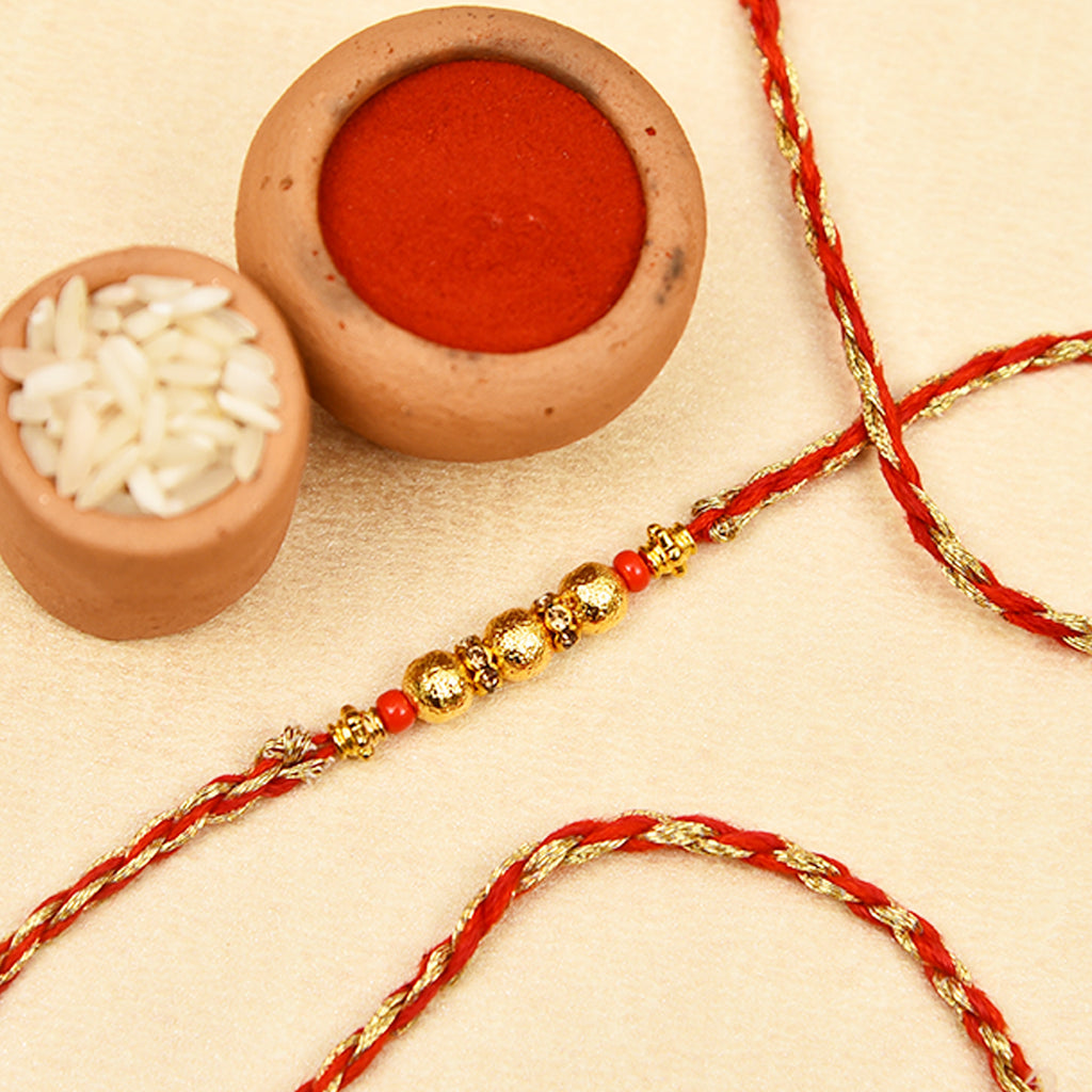 Stunning Golden Beads Rakhi Thread With Stone Work