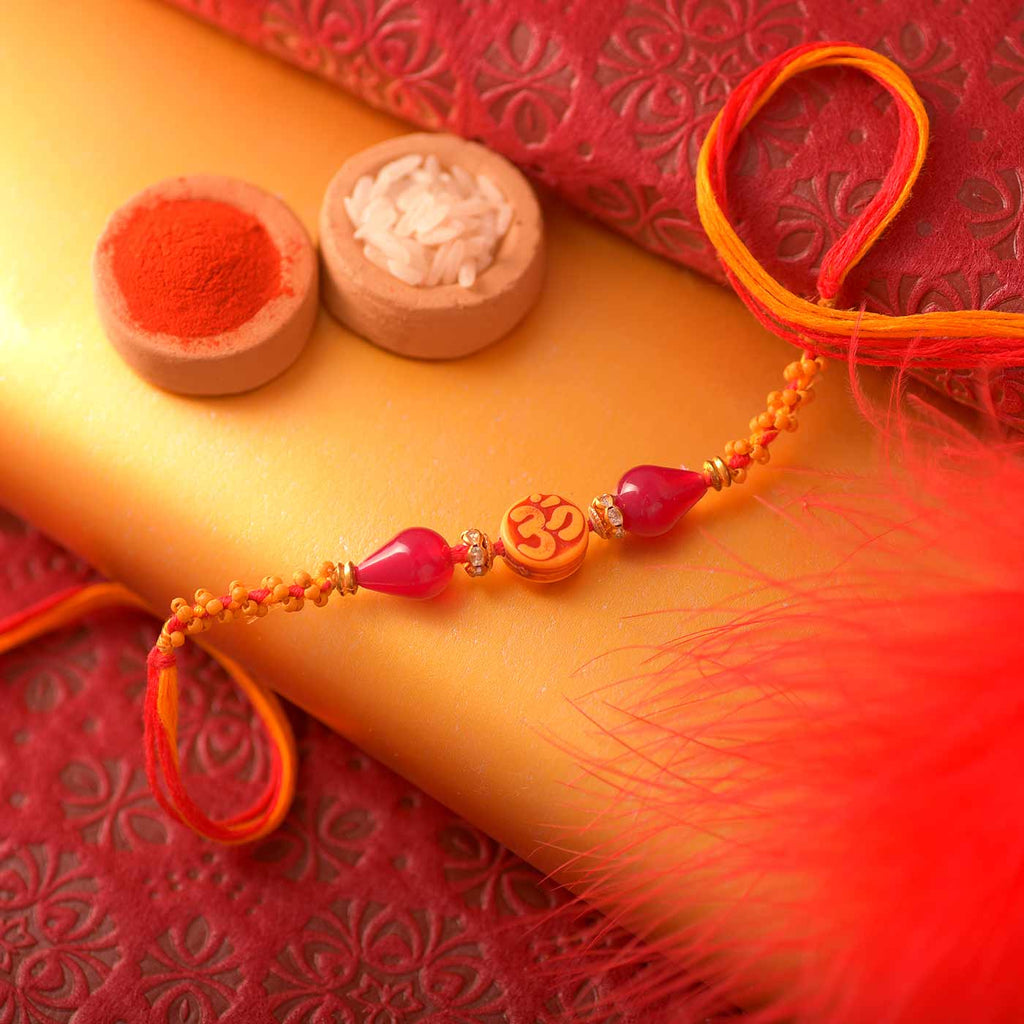 Traditional Om And Crystal Beads Rakhi Thread