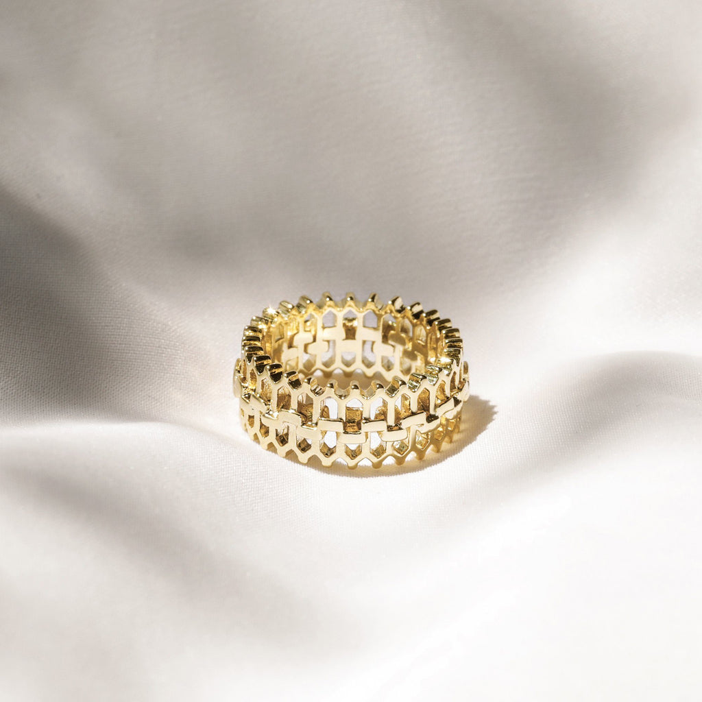 intricately cutout gold band