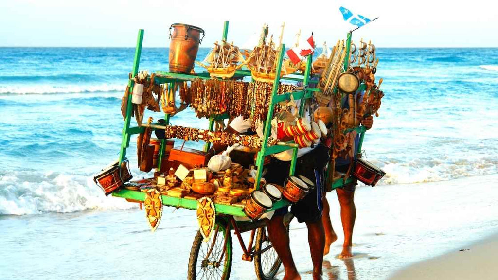 Why we buy souvenirs? the reason of shopping while we travel. Souvenir shop on a beach