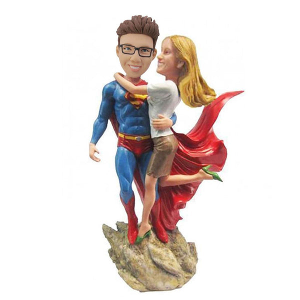 Superman holding a girl Bobblehead