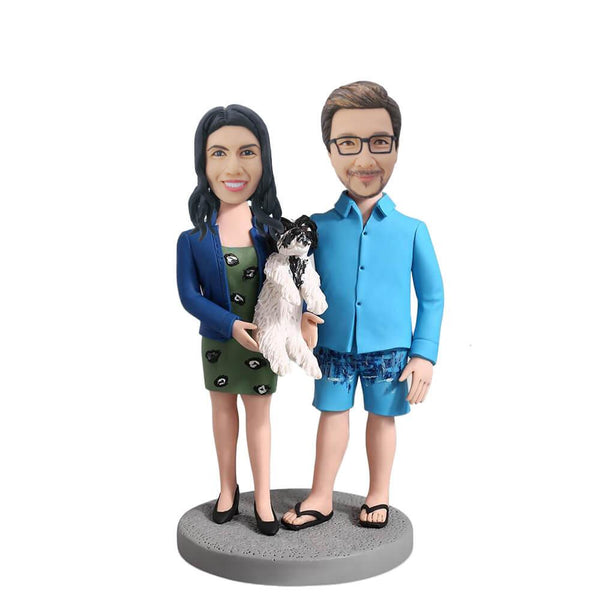 Couple Holding a Dog Bobblehead