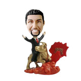 Man riding golden bull bobblehead