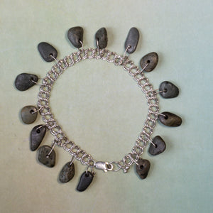 A day at the beach...the sounds of children laughing and waves crashing.  The warmth of the sun.  This is what offers me bliss as I wander the shoreline, choosing the perfect rocks for this handmade bracelet.