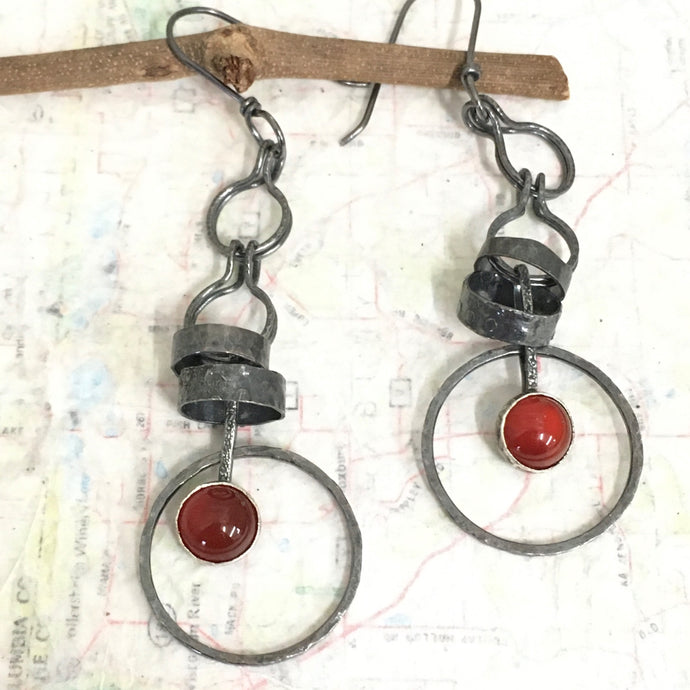 Made with patinated Sterling Silver and Argentium™ these earrings will make you want to dance!  Carnelian contains energy and more than a bit of feistiness so put on those dancing shoes and get moving!  The 6mm Carnelian is set in a serrated bezel.    20g Argentium™ ear wire  3
