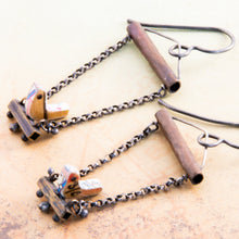 Load image into Gallery viewer, Who doesn't love hanging with a friend, sitting side by side as conversations meander from shoes to the meaning of life?  The handmade earrings feature tiny birds made using vintage rulers are edged in maps and have 1mm Black Spinel eyes.  The swing set is made with copper, brass, Sterling Silver and Argentium®.