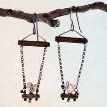 Load image into Gallery viewer, Who doesn't love hanging with a friend, sitting side by side as conversations meander from shoes to the meaning of life?  These handmade earrings feature tiny birds made using vintage rulers are edged in maps and have 1mm Black Spinel eyes.  The swing set is made with copper, brass, Sterling Silver and Argentium®.