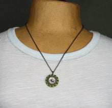 Load image into Gallery viewer, It works!  I know because I had to use my compass necklace one day when I got lost on my bike and didn't have my phone to guide me home!  The compass on this handmade necklace is surrounded by a zipper and a locking tooth washer and sewn to a painted wood and paper support.
