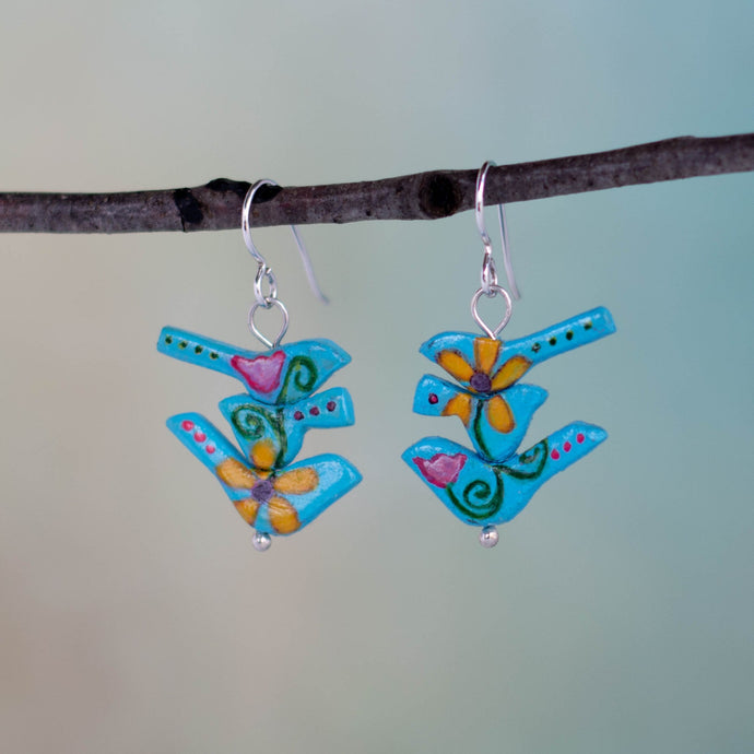 The birds in these handmade earrings wanted a new beginning, a new opportunity and a new trail to travel so they morphed out of a rulerdom and became a tribe of flower power birds.